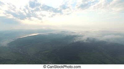 View of the tops of the mountains shrouded by fog