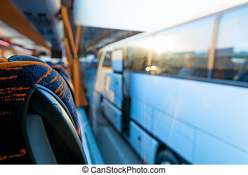 view of the tourist bus through the window