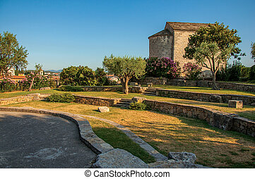 View of the tower clock garden on top of the hill at sunset over Draguignan.