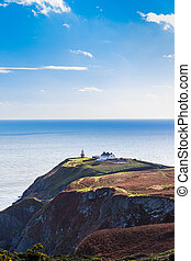 View of the trails on Howth Cliffs with the lighthouse in Ireland
