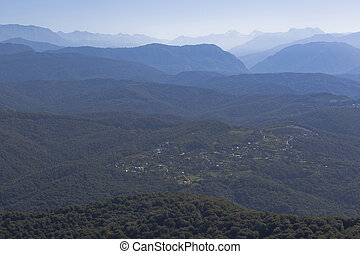 View of the village Hleborob and the Caucasus Mountains from a tower on the mountain Big Ahun