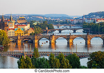 View of the Vltava River and the bridges shined with the...