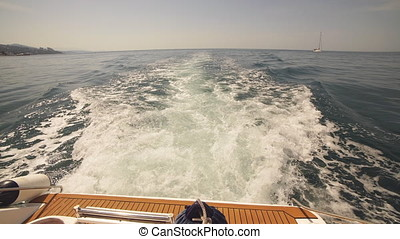 View of the wake behind a sports boat at sea.
