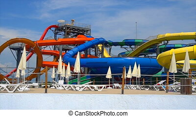 view of the water park, colorful colorful roller coaster,...
