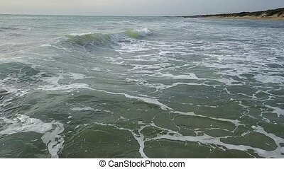 View of the waves from near range and then from the height...