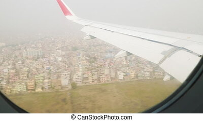 View of the window of airplane in Nepal over the Kathmandu.