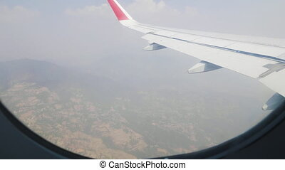 View of the window of airplane in Nepal.