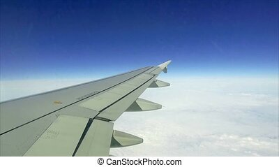 view of the wing of an airplane through the window