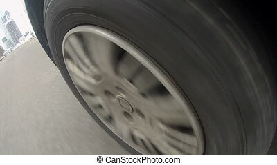 View of tire tread on car wheel