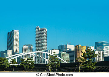 View of tokyo cityscape with blue sky