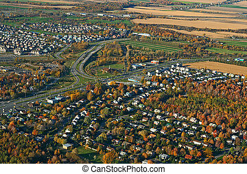 View of town and highway intersection - View of a town and...