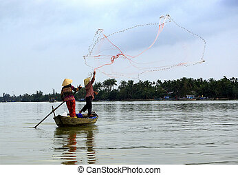 View of two fishermen in action - A view of two fishermen in...