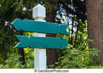 view of two wooden directional signs