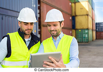 Two young attractives dockers working on the dock