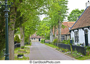 View of typical historic street in Ameland, The Netherlands