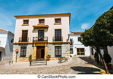 view of typical street in historic district of Ronda, Spain