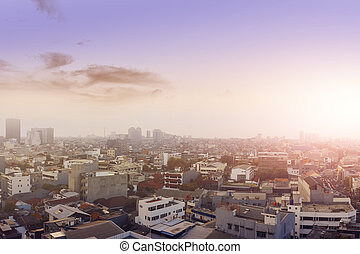 View of urban life with a dramatic sky background