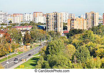 view of urban street in sunny autumn day