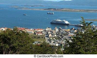 Elevated view of Ushuaia the capital of Tierra del Fuego, Antartida e Islas del Atlantico Sur Province, Argentina. Cityscape with the harbour