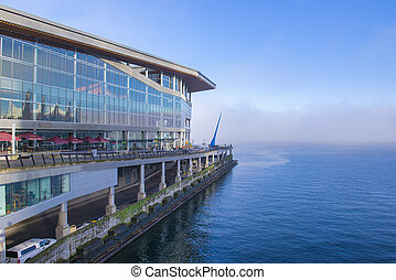 View of Vancouver Convention Centre and cruise ship port during foggy morning hours, BC Canada