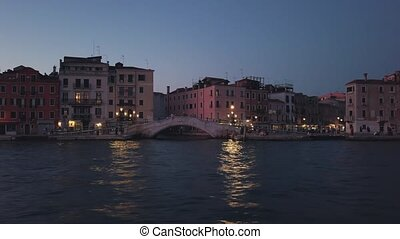View of Venice landmarks sailing in a boat on the canal at...