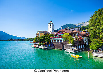 View of View of St. Wolfgang chapel and the village waterfront at Wolfgangsee lake, Austria
