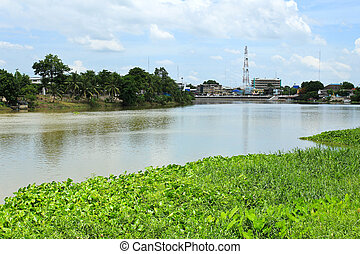 View of waterfront house on meaklong river near Ratchaburi Thailand