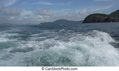 View of waves splashes after speedboat passed, close-up