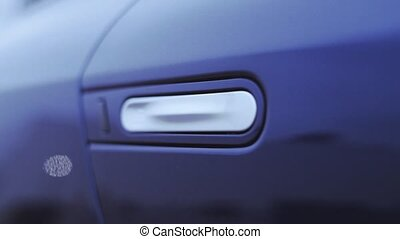 View of white handle on door dark blue new car. Presentation. Showing. Automobile. Cold shades