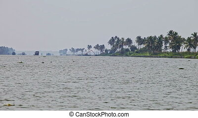 View of Wide River between Palm Banks in Tropics - panorama...