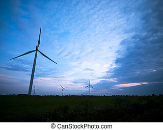 view of wind turbines at dusk