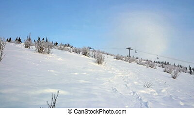 View of winter mountain and ski resort