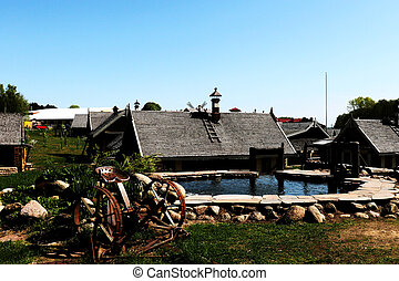 View of wooden old houses in the countryside on a sunny day