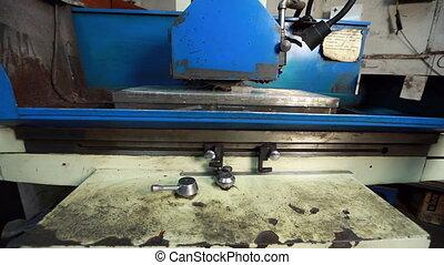 View of work grinding machine at workshop
