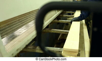 View of worker receives boards from conveyor