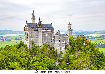 view of world-famous Neuschwanstein Castle under renovation on a cloudy day
