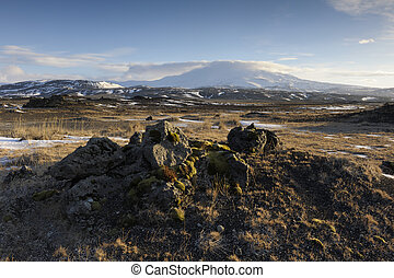 View on a frozen volcanic landscape with Hekla vulcan in background.
