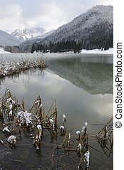 View on a mountain lake in winter.