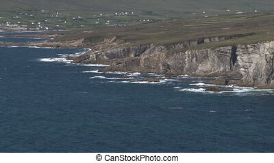 View on a rocky coastline with waves breaking on rocks
