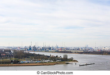 View on an oil refinery in the port of Antwerp, Belgium -...