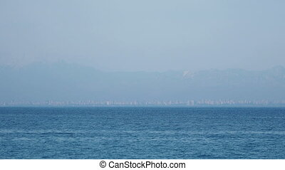 View on Antalya city through harbour from Kemer. Turkey.