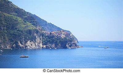 View on architecture of old italian village and beautiful bay. Corniglia is one of the most popular old village in Cinque Terre, taly