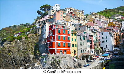 View on architecture of Riomaggiore town. Riomaggiore is one of the most popular old village in Cinque Terre, Italy. SLOW MOTION