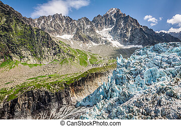 View on Argentiere glacier. Hiking to Argentiere glacier with the view on the massif des Aiguilles Rouges in French Alps