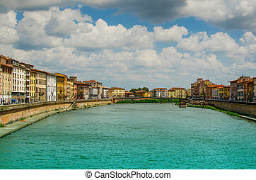 View on Arno River and bridge in Pisa with clouds
