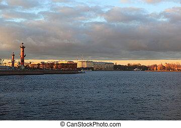 View on arrow of Vasilevsky Island with the Palace Bridge. Autumn evening in Saint-Petersburg