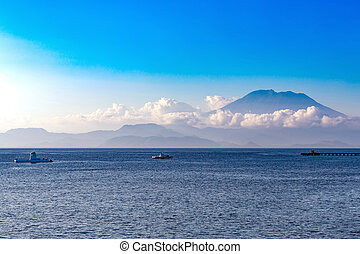 view on Bali from ocean, vulcano in clouds - beautifull view...