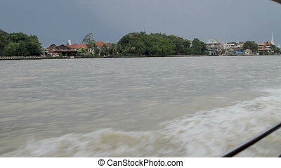 View on Bangkok from moving boat, public transport on Chao...