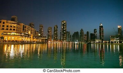 view on beautiful part of city with water and skyscrapers at...