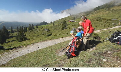 view on bench in mountains with hikers